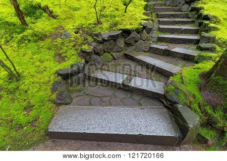Granite Stone Steps Along Green Moss