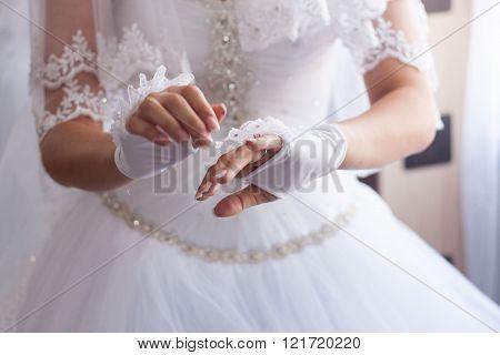 Bride Hands On Wedding Dress