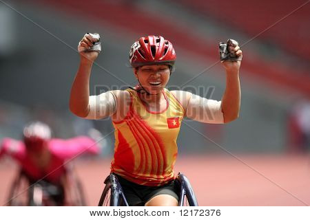 KUALA LUMPUR - AUGUST 15: Vietnam's wheel chair athlete wins the 800m race at the track and field event of the fifth ASEAN Para Games on August 15, 2009 in Kuala Lumpur.
