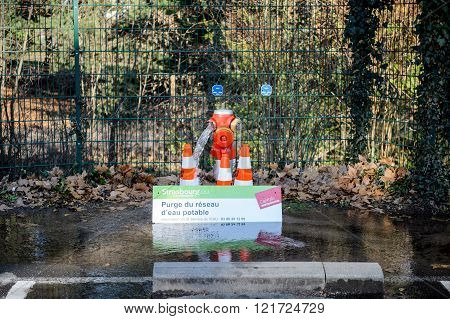 STRASBOURG FRANCE - DEC 25 2015: Purge of the public water system from a hydrant in the French city of Strasbourg
