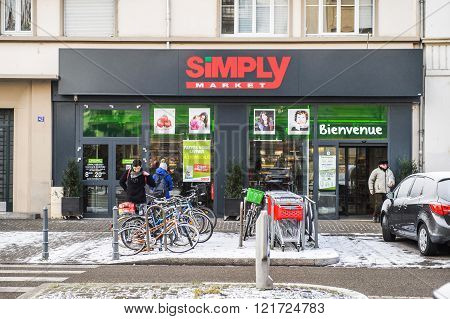 STRASBOURG FRANCE - JAN 20 2016: Modern SIMPLY Supermarket in the French city of Strasbourg on a snowy winter day - Simply Market is a brand of French supermarkets formed in 2005
