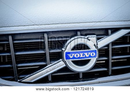 PARIS FRANCE - JAN 20 2016: Volvo Cars logotype covered with snow flakeson car front. Volvo is the only car maker that thas the biggest 5 star NCAP test results