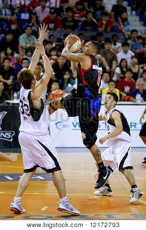 KUALA LUMPUR - NOVEMBER 15: Philippine Patriots' Robert Wainwright outjumps everyone in the ASEAN Basketball League match. November 15, 2009 in Kuala Lumpur.