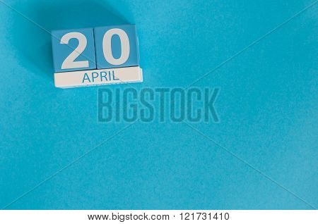 April 20th. Cannabis Day. Image of april 20 wooden color calendar on blue background.  Spring day, e