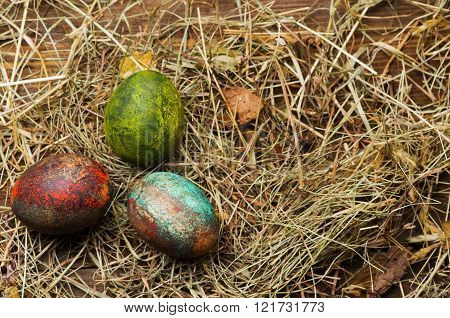 Easter eggs on a wooden table .Rustic style.Top view. Free space for text.
