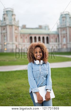 Young girl with laptop in park