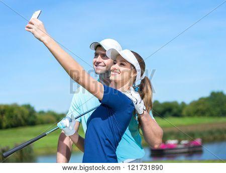 Attractive couple making selfie