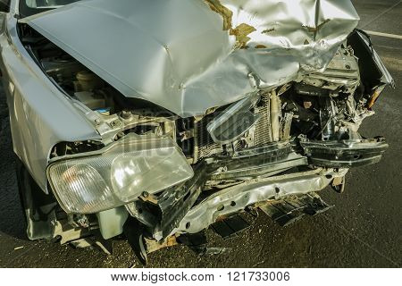 Car crash wreck - insurance concept. A damaged car after a collision on a city street
