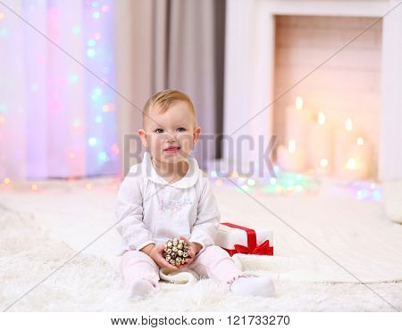 Funny baby girl in Christmas living room