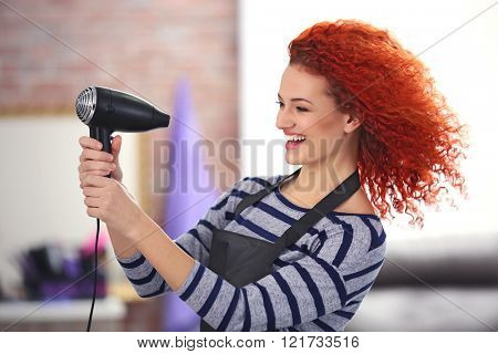 Professional hairdresser with hairdryer
