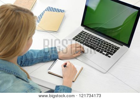 Woman working with laptop in the office