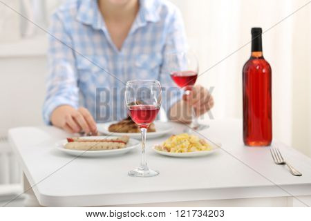 Dinner with glass of wine indoors