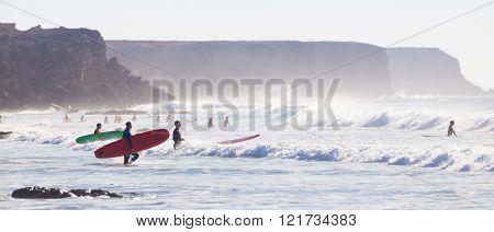 Surfers surfing on El Cotillo beach, Fuerteventura, Canary Islands, Spain.