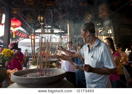 MALACCA - FEBRUARY 16: Devotees pray at the Cheng Hoon Teng Temple during Chinese New Year celebrations in Malacca. February 16, 2010 in Malacca, Malaysia.