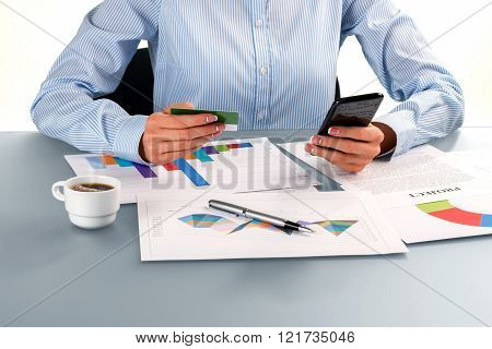 Businesswoman holding plastic card.