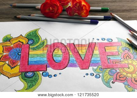 Bright picture with word LOVE, crayons and roses, close up