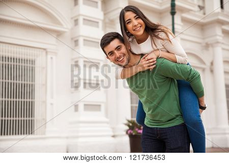 Cute girl piggybacking her boyfriend