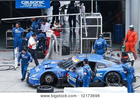 SEPANG, MALAYSIA - JUNE 21: The Calsonic Impul GT-R Nissan car (12) pitting for driver change at the Super GT International Series Round 4 race. June 21, 2010 in Sepang Malaysia.