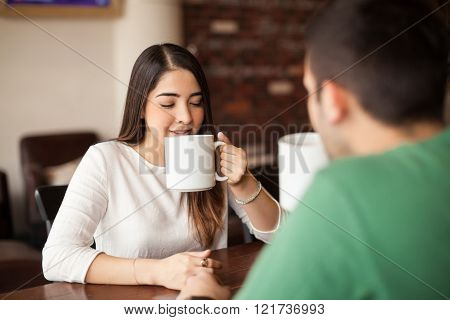 Beautiful girl on a date at coffee shop