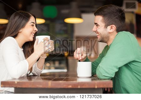 Young Couple Having Fun At A Cafe