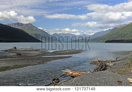 Glacial Stream Entering An Alpine Lake