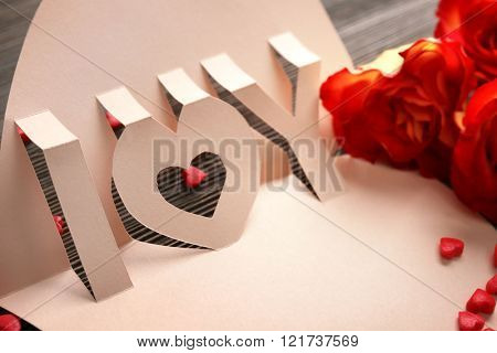 Valentine's Day concept. Beautiful gift card with roses, close up