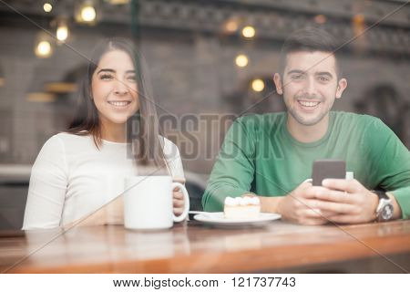 Happy Couple Using Technology