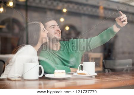 Cute Couple Taking Selfie In A Coffee Shop