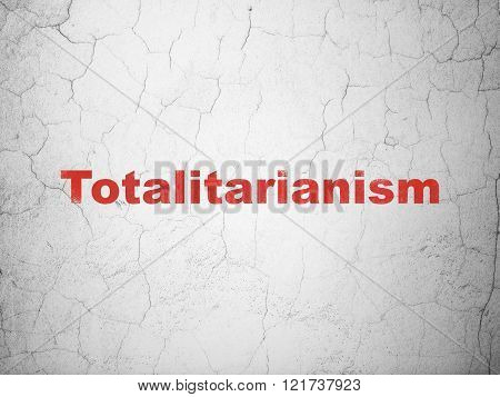 Politics concept: Totalitarianism on wall background