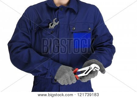 A repairman holding pliers, on white background, close-up