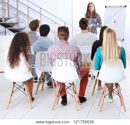 Young people sitting back at the office meeting