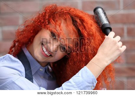 Red haired beautiful girl with comb