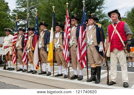 ALPHARETTA, GA - AUGUST 2015: Members of the Sons of the American Revolution stand ready to present colors at the start of the Old Soldiers Day Parade in Alpharetta GA on August 1 2015.