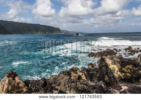 View of the Pacific Ocean near Hana, Maui. Great views of the Pacific Ocean and the East Maui coast line. Contrasting volcanic rocks and the ocean ** Note: Visible grain at 100%, best at smaller sizes