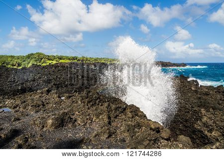 Great views of the Pacific Ocean and the East Maui coast line. Contrasting volcanic rocks and the ocean. One'uli Black Sand Beach Blow Hole