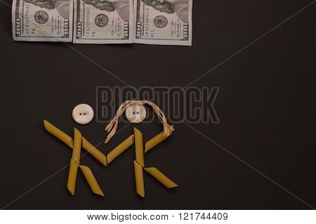 Pasta people dancing under money.  Pasta couple celebrating