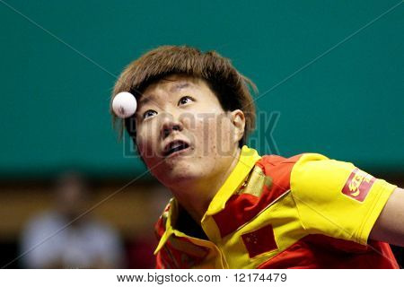 KUALA LUMPUR, MALAYSIA - SEPTEMBER 24: Guo Yan, China (ITTF World Ranking #3) focuses on the ball during the Volkswagen 2010 Women's World Cup in table tennis on September 24, 2010 in Kuala Lumpur.