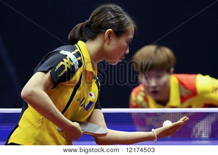 KUALA LUMPUR, MALAYSIA - SEPTEMBER 24: Sayaka Hirano, Japan prepares to serve against Guo Yan of China at the Volkswagen 2010 Women's World Cup in table tennis on September 24, 2010 in Kuala Lumpur.