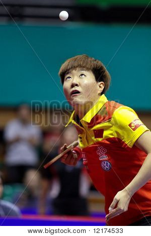 KUALA LUMPUR, MALAYSIA - SEPTEMBER 24: Guo Yan, China (ITTF World Ranking #3) tosses the ball at service at the Volkswagen 2010 Women's World Cup in table tennis on September 24, 2010 in Kuala Lumpur.