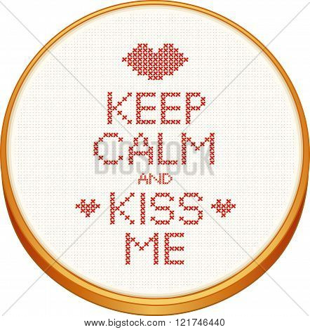 Keep Calm and Kiss Me cross stitch embroidery on wood embroidery hoop with love, a big kiss and hearts, white Aida even-weave cloth texture background needlework sampler isolated on white.