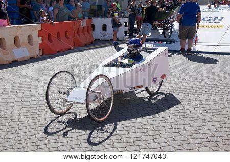 COCKBURN CENTRAL,WA,AUSTRALIA-MARCH 13,2016: White billy cart with driver racing at the Cockburn Central Billy Cart Festival in Cockburn Central, Western Australia.