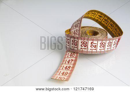 sartorial meter on white  background