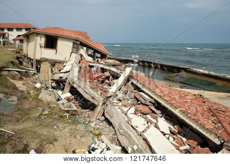 Erosion at seaside resort from climate change situation wave broken building very unsafe danger environment risk of worldwide when sea level rise by warming scene at Cua Dai Hoi An Vietnam poster