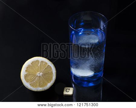 Vitamin C Tablet Bubbles In Glass Of Water And Lemon