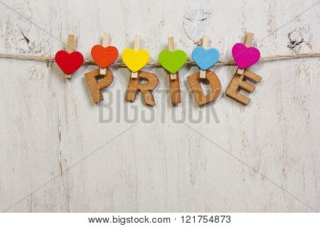 The word pride with rainbow hearts