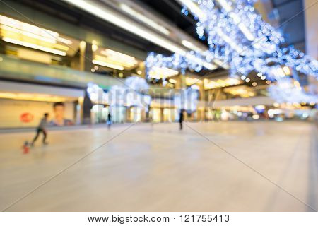 Blur background image of ice skating rink with bokeh of decoration light bulbs