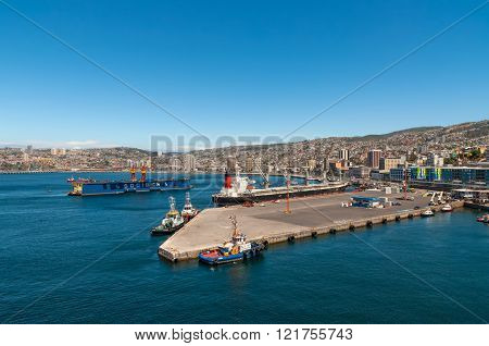 Valparaiso, Chile - December 3, 2012: Panoramic view to the cargo sea port and residential area of Valparaiso city on December 3, 2012 in Valparaiso, Chile.