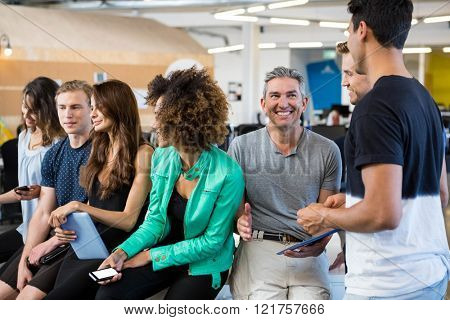 Group of businesspeople interacting during break time in office