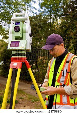 Surveyor checking his measurements