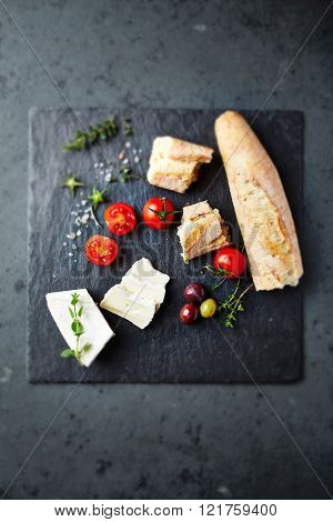 Brie with cherry tomatoes and baguette
